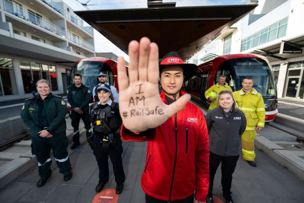 """Person holding up hand with words """"I am #RailSafe"""""""