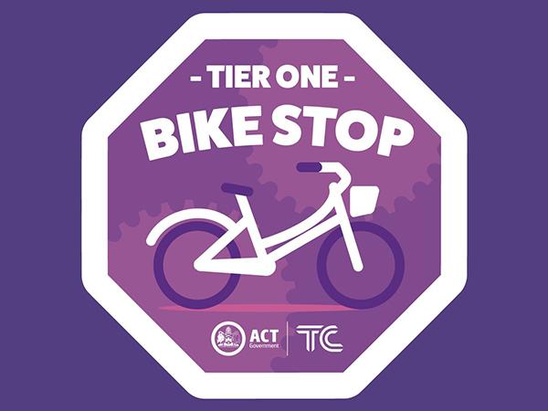 Purple bike stop logo